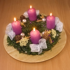 Christmas wreath with violet candles