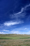 Rural fields landscape with fantastic white clouds, blue sky. poster