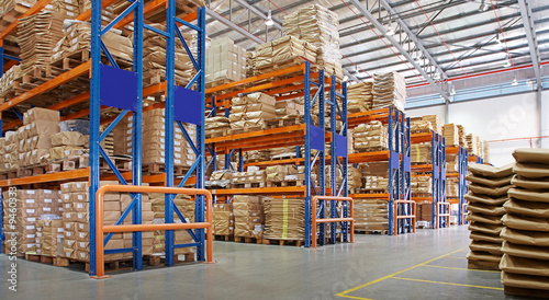 Staande foto Industrial geb. warehouse with multilayer racks in a factory