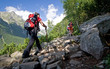Nordic walking in mountains. Young female. - 9463965