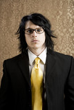 Well-dressed businessman with a yellow tie and thick glasses poster