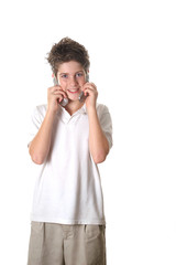 young boy talking on two cell phones full shot