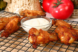 Chicken wings AKA buffalo wings and ranch dressing. poster