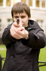 outdoor portrait of a man with gun