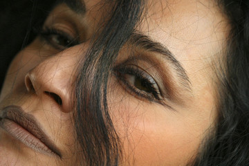 close up of woman's face with hair in front