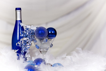Blue holiday decorations with a soft white background