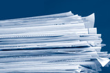 a stack of due  monthly bill payments in blue tones poster