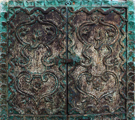 fine detail of green ancient door