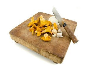 Chanterelle mushrooms on a rustic cutting board