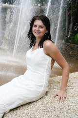 Gorgeous young bride by a waterfall.