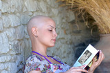 Cancer survivor while reading her book in positive attitude - 9479967
