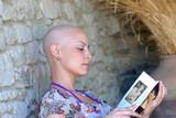 Cancer survivor while reading her book in positive attitude poster