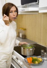 Young woman prepare meal in the kitchen