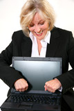 Attractive 40 something woman upset with her laptop.