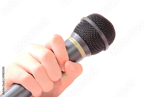 hand holding a microphone on white background