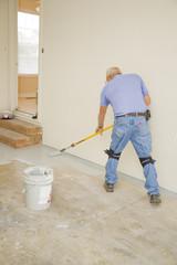 Contract painter painting garage floor