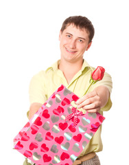 young man wih rose and pink bag, isolated on white background