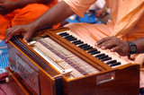 Krishna Devotee Playing Harmonium