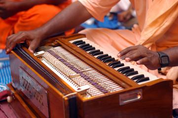 Krishna Devotee Playing Harmonium