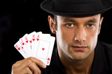 man with Royal Flush Poker Hand - isolated over a black