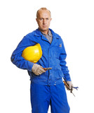 serious worker holding his hardhat and different tools poster