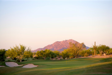 Golf course in the Arizona desert with mountains
