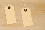 Two swing tags on wooden board background poster