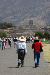 Tourists walking in remains of Teotihuacan