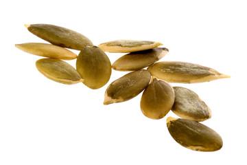 Isolated macro image of pumpkin seeds.