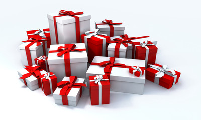 White gift box with red ribbon in the middle of a pile