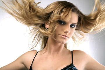 Fashion portrait of a girl with hair up in the air