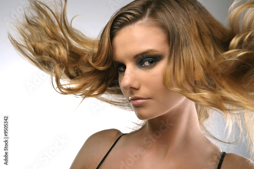 Girl with hair lightly fluttering in the wind.