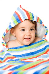 Portrait of happy 8 months old Baby girl in vivid colors.
