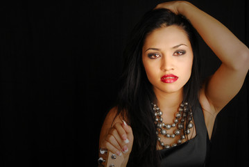 latino female rocker with dramatic lighting on her face