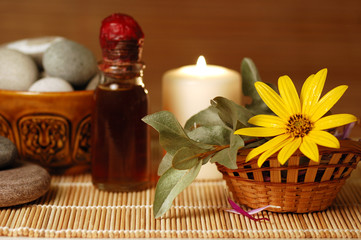 candle, pebble stones, massage oil, flower for spa