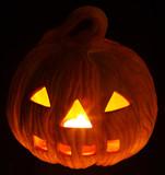 A scary old jack-o-lantern on black, pumpkin. poster