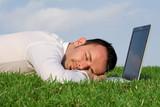 tired man asleep at laptop poster