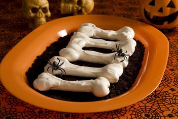 Halloween meringue bones on dirt (crashed Oreo Cookies)