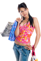 Young brunette girl with shopping bags, isolated on white