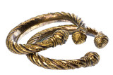 Isolated image of a pair of antique brass ankle bangles. poster