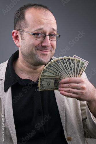 middle-aged successful businessman with money