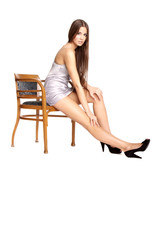 young woman in underwear sitting on chair