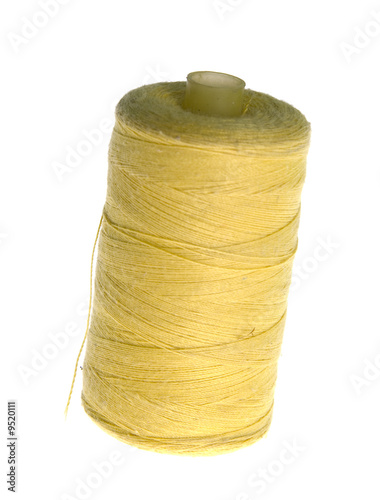 Yellow thread isolated on white background