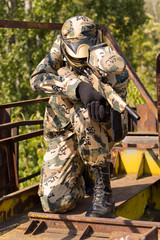 Paintball player in action outdoors