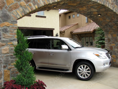 SUV Parked in a Driveway - 9524984
