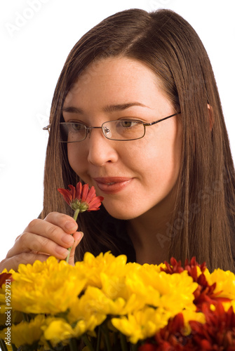 Woman smelling valentine or gift flowers isolated on white