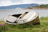 old wooden boat on shore grass of fjord in Norway poster