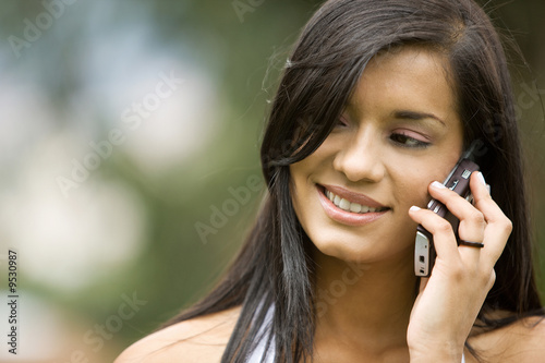 casual woman smiling and talking on a mobile