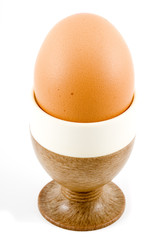 a brown soft boiled egg in the eggcup