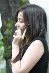 young girl call and smile
